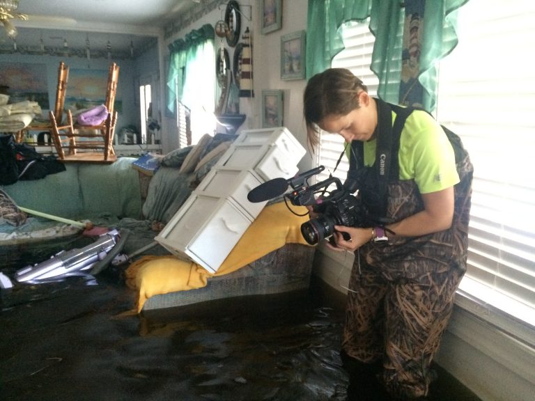Brittany prepares to film the floods in South Carolina, along with local reporters. In addition to capturing 360 content, Brittany also shoots fixed frame videos.