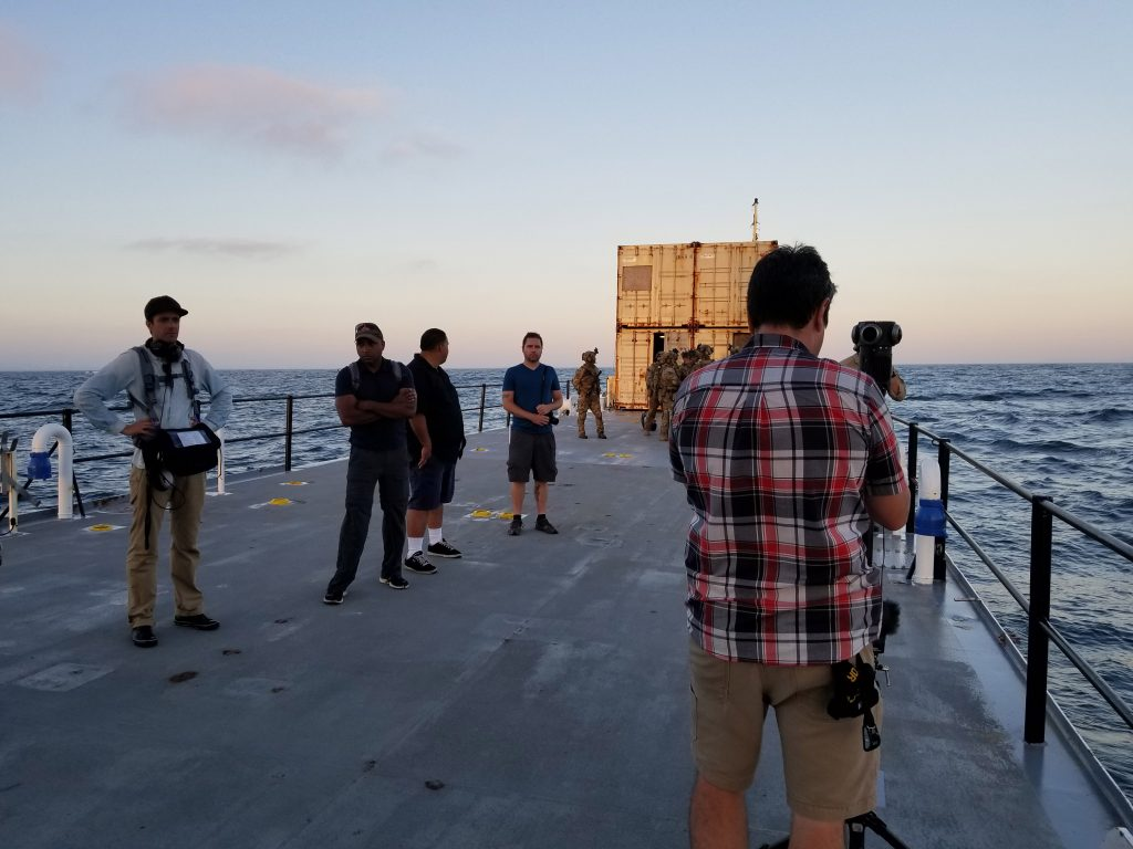 Thomas Hayden prepping the Z-cam S1 Pro for the final shot of the evening, on the deck of the Atlas, a training ship.