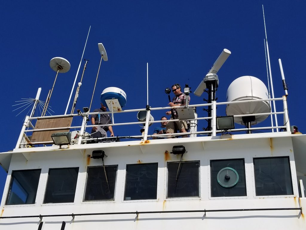 Thomas Hayden rigs the GoPro Omni on the top deck of the Atlas.