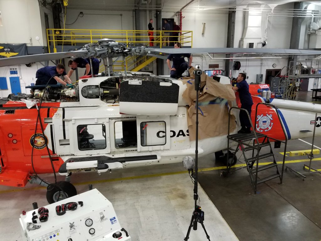 A USCG mechanic crew doing maintenance on an MH60 Helicopter at Air Station Astoria.